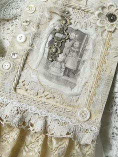 Beautiful framed pictures with lace, buttons and more. Lots of ideas and framed pictures on this site.