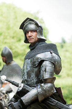 The armor is about 4 centuries too recent, but I'll take him for Alain (Sir Robert Alain de Bellencombre), hero of SNOW IN JULY by Kim Headlee. <3