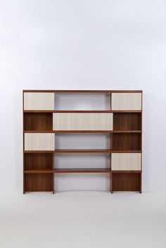 Ilmari Tapiovaara; #7954 Teak and Fabric Shelving Unit for Mobile Cantu, 1957.