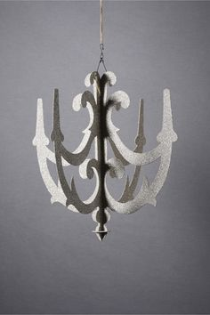 """WEDDING TIME// DECOR: Baroque Cut-Out Chandelier from www.BHLDN.com  Style: 21180104  An exemplary piece, Wendy Addison adorns her silvery chandelier with German glass glitter from arm to arm and head to toe. Two interlocking pieces ship flat packed; simple one-step assembly Cardboard, German glass glitter.   Handmade in USA.   24""""H, 22.5""""W"""