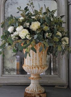 the French Bedroom Company Blog, Meet The Floristas - we interview our favourite local florists for their top tips on getting perfect wedding flowers and bridal bouquet. With Forage Flowers and Tigers to Lilies.A vintage antique urn filled with white roses and eucalyptus for a french wedding day centre piece