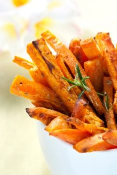 - 2 large sweet potatoes cut into fries - 1/4 cup coconut oil - 1 bunch of fresh basil - 1 cup shredded coconut   1. Heat coconut oil in a fry pan 2. Add fries (each one should be coated) 3. Cook fries to a golden brown & then gradually add basil & coconut (optional: ADD 1 tbsp himalayan salt = sweet & salty)  Time: 30 min