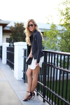 Embellished white shift dress, leather biker jacket, black heels, aviators