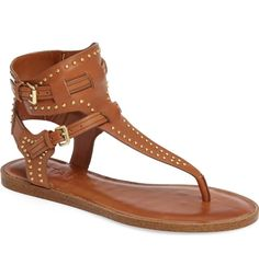 An ankle strap sandal minimally detailed with polished hardware will keep the summer outfits looking simple and chic.