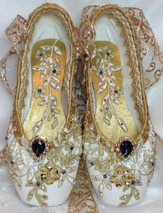 PAIR of white & gold decorated pointe shoes with blue vintage
