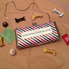 """NWT Kate spade """"CHA CHA chocolate"""" metal clutch Absolutely adorable metal clutch with chocolate Bon Bon closure. Metal chain for shoulder strap that can be folded into the purse if you want it to be a handheld. kate spade Bags Clutches & Wristlets"""