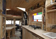 The Morisons exhibited their self-sufficient wooden house-truck, customized from a decommissioned fire engine and containing, next to a stov...