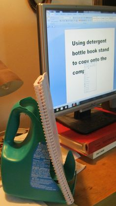 Book stand made out of large detergent bottle.  Oh how this could have been useful for all those nights trying to type papers.