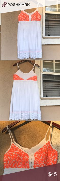 Free People Summer Dress Beautiful White dress with orange embroidery on bust and back. Nice lace Hem and lined on the inside. Perfect for this summer. In great condition. Offers welcome. 😊 Free People Dresses