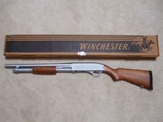 Winchester 1200 Police.  The wood and satin stainless steel makes this gun look traditional and modern at the same time.  Beautiful.