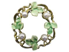 Pretty faux pearls and green enameling circle into a wreath of beauty with this eye catching Gerry's brooch.