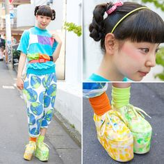 Pani is a 17-year-old student who we met in Harajuku. She's wearing colorful fashion from the Harajuku resale shop Kinji along with Spinns (スピンズ) platforms and mismatched socks. -TokyoFashon