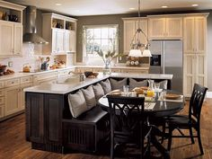 Kitchen island with integrated booth seating. Very cool !!