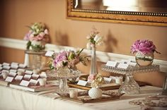 Glass, rose glass, milk glass and silver treys used for an elegant vintage wedding table display.