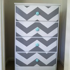 DIY chevron dresser. Cathedral grey and restoration white (lowes valspar). Chevrons are 3in wide and about 3.5in apart. A great way to revive an old (and free!) dresser.