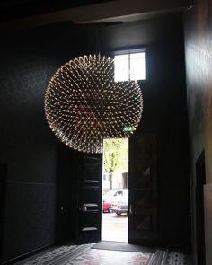 Raimond by Raimond Puts via Moooi   www.moooi.com   #lighting #fireworks #architecture #interiors #foyer #dark #black #trendy #lightfixture #lamp #design