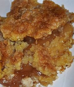 2 cans of apple pie filling 1 box of yellow cake mix 2 sticks of butter, melted  1/2 cup caramel sauce  1/2 tsp cinnamon In a greased 9x13 dish, mix pie filling and caramel sauce.  add in the 1/2 tsp cinnamon if desired. Spread evenly in pan.  Pour dry cake mix directly on top of the pie filing and spread evenly. op with melted butter and pecans.  Bake at 350 45-50 minutes or until top is golden brown and filling is bubbly around the edges.  Serve with ice cream or whipped cream.
