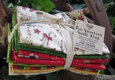 You will find a little bit of Christmas year round at Fat Quarters Quilt Shop... this yummy little bundle of holiday joy is now cut and ready for YOU ;-) Peppermint Lane by Sue Zipkin for Clothworks...