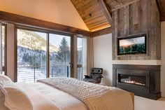 Morningstar contemporary wood paneled bedroom with snowy mountain view by Studio123