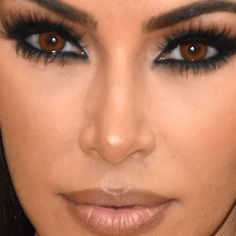 Kim Kardashian maintained her title as Queen of the Smoky Eye with dramatically long, curled eyelashes that popped even more with hazel contacts. Hazel Contacts, Hazel Eye Makeup, Blue Eye Makeup, Eye Makeup Tips, Makeup Ideas, Kim Kardashian, Makeup Looks 2018, Makeup Filter, Eyebrow Jewelry