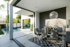 Contemporary Home with Pool has Black and White Interior