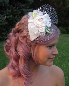 Teardrop bridal cap with silk fleurs, freshwater pearls & Russian veil. This can worn on a comb, clip,or headband. $120