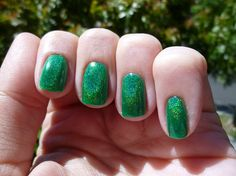 Enkelini The Grass Is Greener.  Strong linear holo.  Swatched on nail wheel.  Etsy Store closed now.  $10 shipped.  Jennifer Amaro