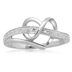 Give her a gift she'll cherish always with the stunning Sterling Silver Diamond Heart Ring. The ring measures .39 inch high and is made from high-quality 925 sterling silver for a long-lasting shiny finish. Lined with round white diamonds of IJ color and I2-I3 clarity, the ring has a double ribbon shape that is unique and modern. The smooth silver ribbon curves around itself to form a heart shape at the center of the ring. A thin band finishes the back of the ring, providing