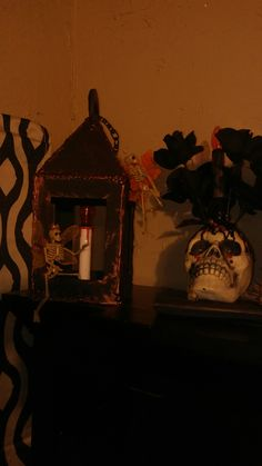 Lantern with fairy skeleton from cardboard that I made and skull candle with black roses Rhiannon made
