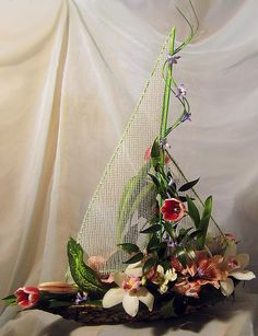 Could see this design with more masculine flowers for a sailor gone to sea for the last time.