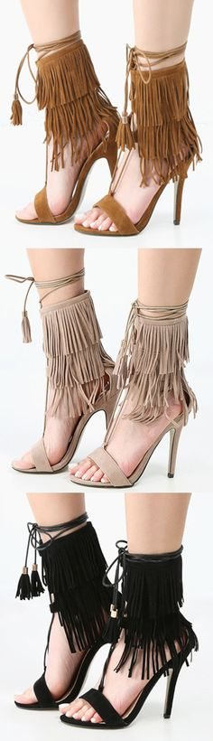"""Fab fringe awaits you in the Single Sole Lace Up Fringe Stiletto Heels! These trendy heels feature a faux/vegan suede upper, open toe, and triple fringe design. Finished off with a slightly padded sole for added comfort, and 4"""" stiletto heel. Wear with a longline waterfall vest for a luxe boho ensemble!"""