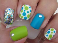 Like the blue and green and the polka dots, skip the silver dots and the shiny nail. Looks like summer beachy nails!