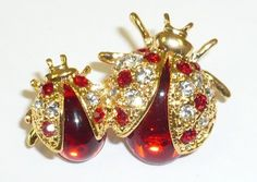 2 Red Crystal Ladybug Pin Goldfinger,http://www.amazon.com/dp/B004XRR2AW/ref=cm_sw_r_pi_dp_zvBXsb0DCW6K8MGA
