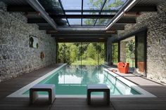 The popularity of indoor pools is partly due to their extreme versatility. People can swim in indoor pools at any point during the year, regardless of the Indoor Pools, Pools Inground, Light Steel Framing, Casas Country, Houses In Poland, Glass House Design, Interior Design Examples, Design Ideas, Design Inspiration