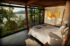 Located on Lake Villarrica, in the heart of Chile's lake district, the Hotel Antumalal is one of the country's most storied hotels. The Bauhaus design, conceived by Jorge Elton who was a student of Frank Lloyd Wright, is retro-chic and lovingly maintained, with wraparound glass windows, goatskin rugs, tree trunk furniture and walls made with thick slabs of monkey puzzle wood. Trunk Furniture, Outdoor Furniture, Outdoor Decor, Resorts, Chile, Design Bauhaus, Frank Lloyd Wright, Retro Chic, Lake District
