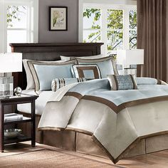 Elegant luxurious blue and brown bedding Looks like a luxury hotel