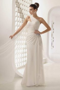 We love the glamorous Grecian vibe of the 17506 one shoulder wedding dress from Victoria Jane