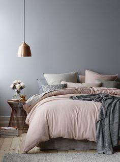 Copper pendant and blush grey bedding
