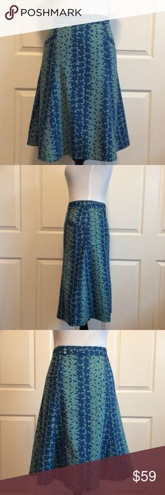"""Breezy Cotton Floral Skirt Designer navy and green floral print cotton skirt. Great condition. Fully (cotton) lined. Front pockets. Zips off center at back. Pair with a cream top & sandals for a breezy Summer look. Labeled size 6 but runs slightly larger, IMO. would be easy to tailor. Measured across and laying flat; 15.5""""W, 20.5""""Hip, 23.5""""L. First four photos show true to color. Marc Jacobs Skirts A-Line or Full"""