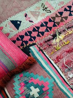 Mix and match rugs in teal and fuchsia - cute for a girl. Mix boho and eclectic