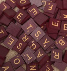 100 Scrabble Letter Tiles in Maroon and Gold with bag. $17.00, via Etsy.