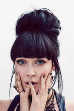 Want a polished yet edgy look? Try pairing a high bun with blunt fringe. sexyhair.com