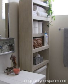 Small bathroom ideas: build you own simple DIY over the toilet storage cabinet that you can customize to fit your bathroom!