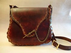 This handmade custom leather shoulder bag measures approximately 12 x 12 and has a 3 tapered gusset. It features a secure antique brass pin clasp Brown Leather Crossbody Bag, Leather Shoulder Bag, Leather Bags, Pioneer Clothing, Wave Pattern, Custom Leather, Purses And Handbags, Saddle Bags, Jewels