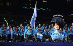 Swimmer Guillermo Marro of Argentina carries the flag during the Opening Ceremony of the London 2012 Paralympics at the Olympic Stadium on August 29, 2012 in London, England.