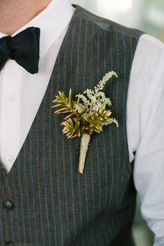 gold spray-painted succulent boutonniere, photo by CarolineRo http://ruffledblog.com/charity-inspired-wedding-ideas #gold #boutonniere #groom