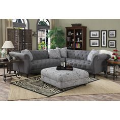 Lend a touch of glamorous appeal to the living room with this lovely tufted sectional sofa, showcasing brushed chrome nailhead trim and a gray hue. ...