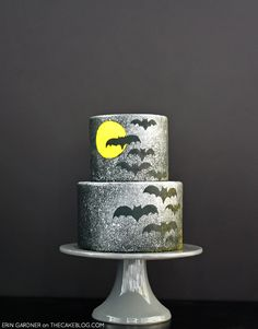A quick and easy Halloween Cake DIY. Learn how to use a $1 spray bottle to create an airbrush splatter technique. A spooky bat cake by Erin Gardner of Wild Orchid Baking Co.