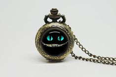 Vintage Glass Pocket Watch Necklace with Inspired Alice in wonderland cheshire cat on Etsy, $24.90