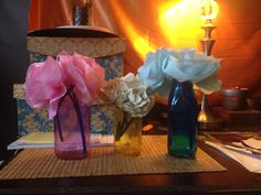 Paper flowers in dyed jars